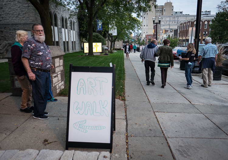 A sign directs visitors into an exhibit at First Presbyterian Church in Flint during ArtWalk. ArtWalk brings visitors from Flint and surrounding communities into more than 20 different venues to view art.