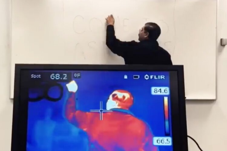 Rajib Ganguly, Ph.D., associate chair of the physics department at UM-Flint, shows how an infrared camera works.