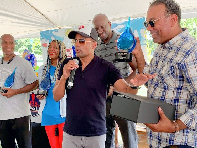 Hill Harper presents community awards at Haskell Community Center.