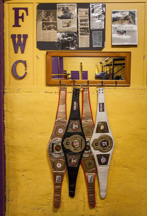 Championship belts belonging to current Berston boxers hang in the boxing gym in Flint.