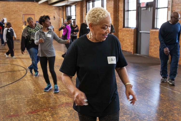 Lola Carter of Flint goes through the steps during a line dancing class at Berston Field House in Flint. The class is mostly women but there were three or four men  also dancing on this day.