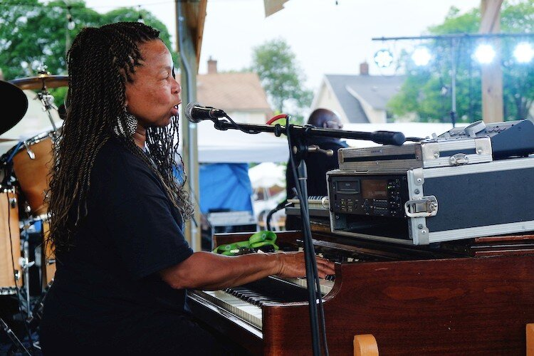 Beverly Davis, head coordinator of the Heritage and Harmony festival, croons while playing the jazz organ on July 4, 2019.