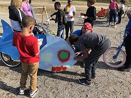 "Artists, parents, and other community members helped kids paint and design ""silly bikes"" for a parade on November 7."