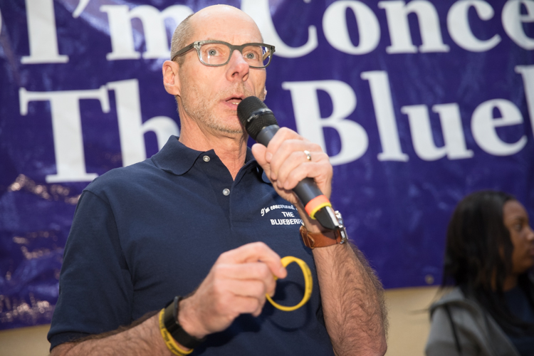 Blueberry Founder Phil Shaltz explains the new gold wristbands given to Blueberry Blue Ribbon Award winners.