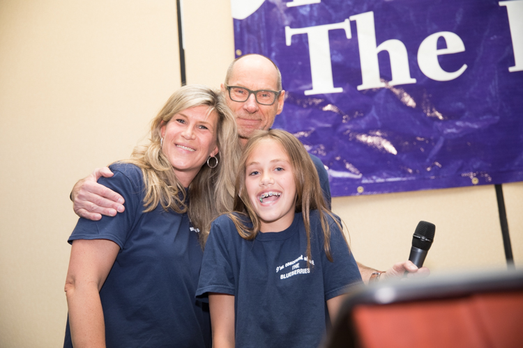 Blueberry Founder Phil Shaltz congratulates teacher Kristie Philpott and fifth-grader Katie Roti, who won the Founder's Award.