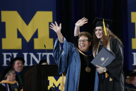 Chancellor Susan E. Borrego celebrates with a student during the December 2018 commencement.