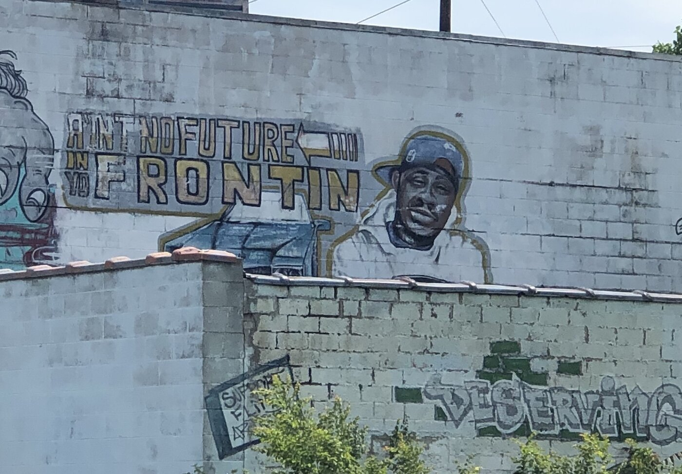 A mural honoring MC Breed is located near Fox Street and Glenwood Avenue in Flint.