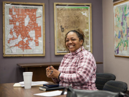 Carma Lewis brings personality, joy and deep commitment to her work at the Neighborhood Engagement Hub on Martin Luther King Avenue in Flint.