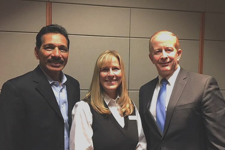 Outgoing Metro Community president Ravi Yalamanchi (left) poses with board chair Rachelle Kippe and new MCD CEO Brian Glowiak.