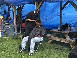 Roy Nichols, founder of Charity C.U.T.S. finished up a haircut at Berston Fieldhouse.