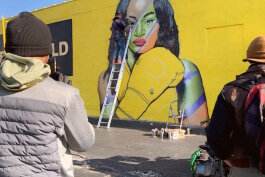 Local muralist Charlie Boike painting a mural of Claressa Shields on the side of Julie's Pawn shop on 2820 South Saginaw for Flint's Free City Mural Festival on Saturday, October 12.