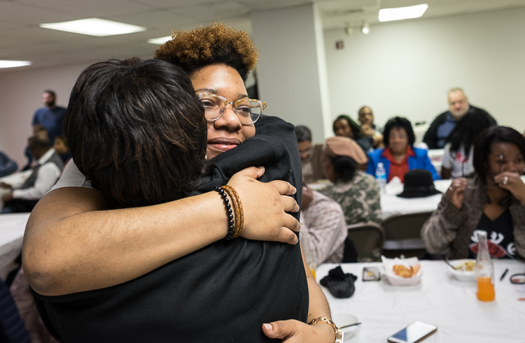 Talicia Campbell, owner of Chef Telly, receives congratulations after winning the microgrant at the Flint SOUP event in January.