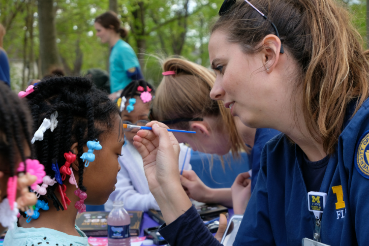 Nursing students from the University of Michigan-Flint volunteered to do face-painting during the Civic Park Summer Kickoff Celebration.