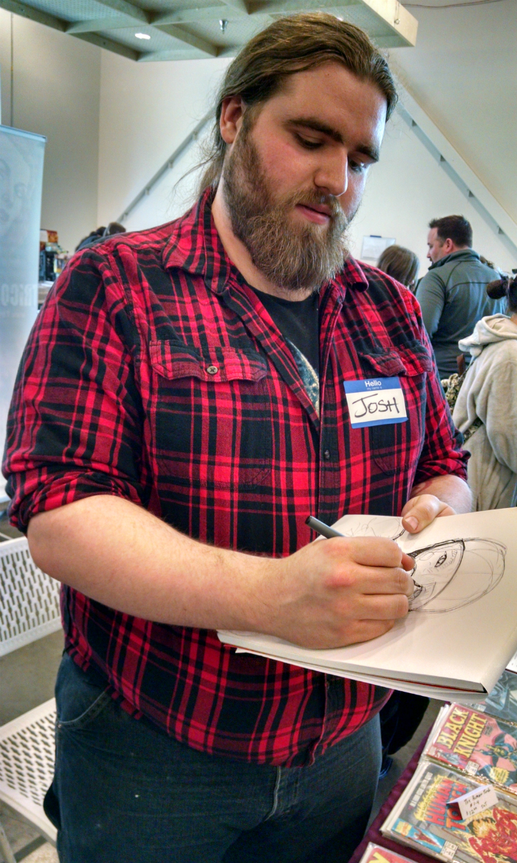 A sketch artist at the Flint Comix Con in the spring at the Flint Farmers' Market.