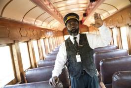 """All aboard,"" calls Larry Coleman, conductor at Huckleberry Railroad, to usher guests to their seats for the 40-minute trip from Crossroads Village along the shore of Mott Lake and down the historic Pere Marquette railbed."
