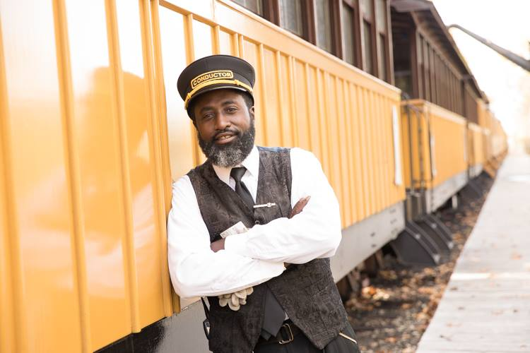 As a conductor for the Huckleberry Railroad, Larry Coleman hosts guests, ensures their safety, makes sure every trip runs smoothly—and throws in a little storytelling as the train chugs along its 40-minute route.