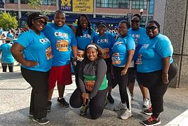 The 2017 Brownell-Holmes CrimFit Adult Training Program team poses for a picture before the race.