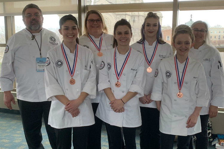 Mott Community College's 2019 Culinary Knowledge Bowl team (left to right): Chef Mark Handy, Martina LaNoue, Jennifer Stock, Kinleigh Jaehnig, Jessalyn Taylor, Dawn Neusbaum, and Lata VonBrockdorff.