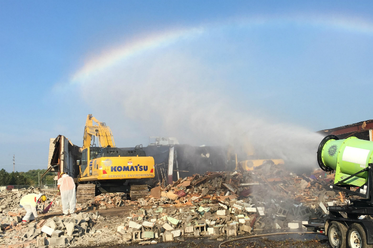 Water sprayed on a demolition site creates a rainbow at at Clio and Pierson roads. This is one of six major commercial demolitions planned by the Genesee County Land Bank.