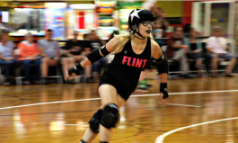 Ashley MacDermaid, aka, Ash Tray, races out of the pack past opponent blockers, becoming the lead jammer for the Flint City Derby Girls. The lead jammer can also end scoring against the opposing teams jammer during a two minute round.