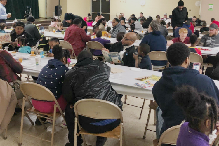 About 60 fathers and their children enjoyed Donuts with Dad at Durant-Tuuri-Mott Elementary School. Then, the dads signed up to be volunteers.
