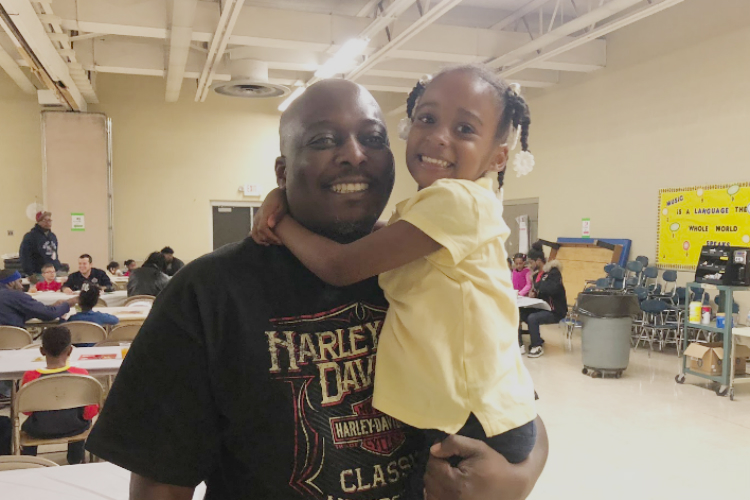 Monté Collins with his daughter, Brooke, 5, at Donuts with Dad at Durant-Tuuri-Mott Elementary.