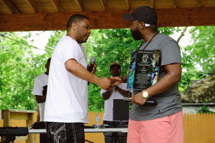 After his showcase performace, Jon Connor, Flint native rapper and producer, was presented with a V2xV studio recognition plaque for his musical contributions on behalf of the Flint community.