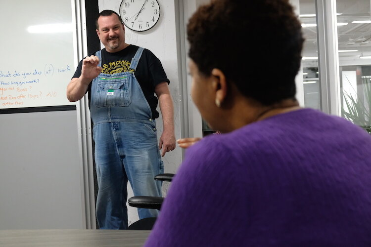 Co-teacher Brian Whittington graduated from Michigan School for the Deaf and Blind in 1985 and volunteers to help teach Linda Bell's ASL classes.
