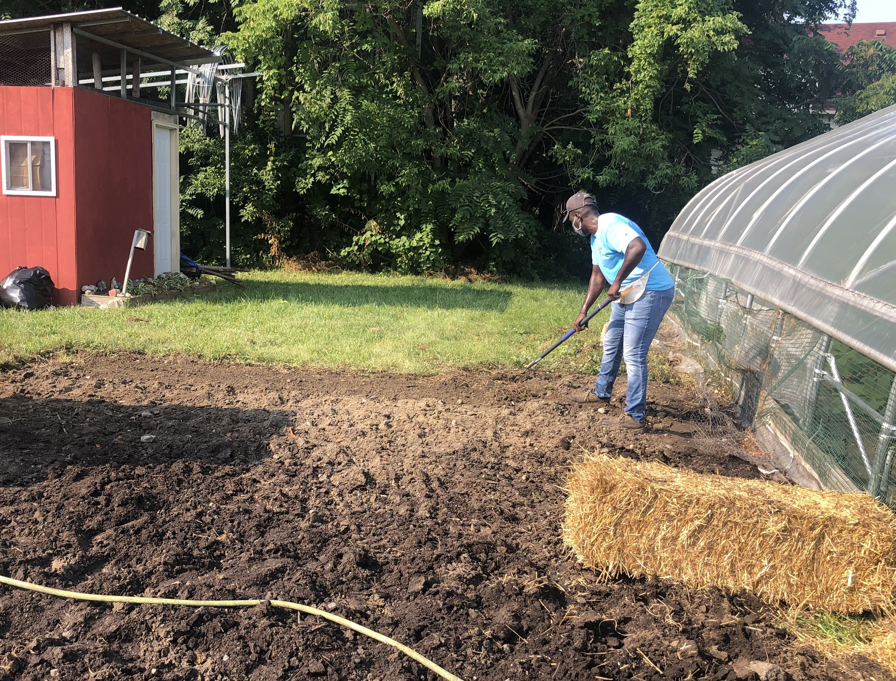 Ge'Von Collins works on the Edible Flint Educational Farm.