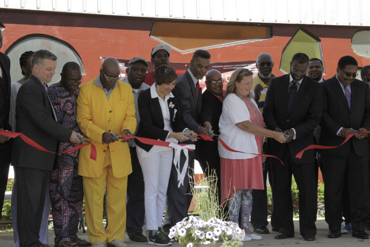 Flint Development Center celebrated its official ribbon-cutting and grand opening on Thursday, June 8, 2017. The multi-purpose facility will house offices and programs of the Genesee County Parks and Recreation Commission, YMCA of Greater Flint, Flin