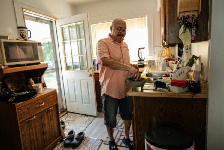 Ricky Reyes' kitchen still holds many of the same cooking tools his mother used to make staple meals, like the molcajete used to crush herbs and spices.