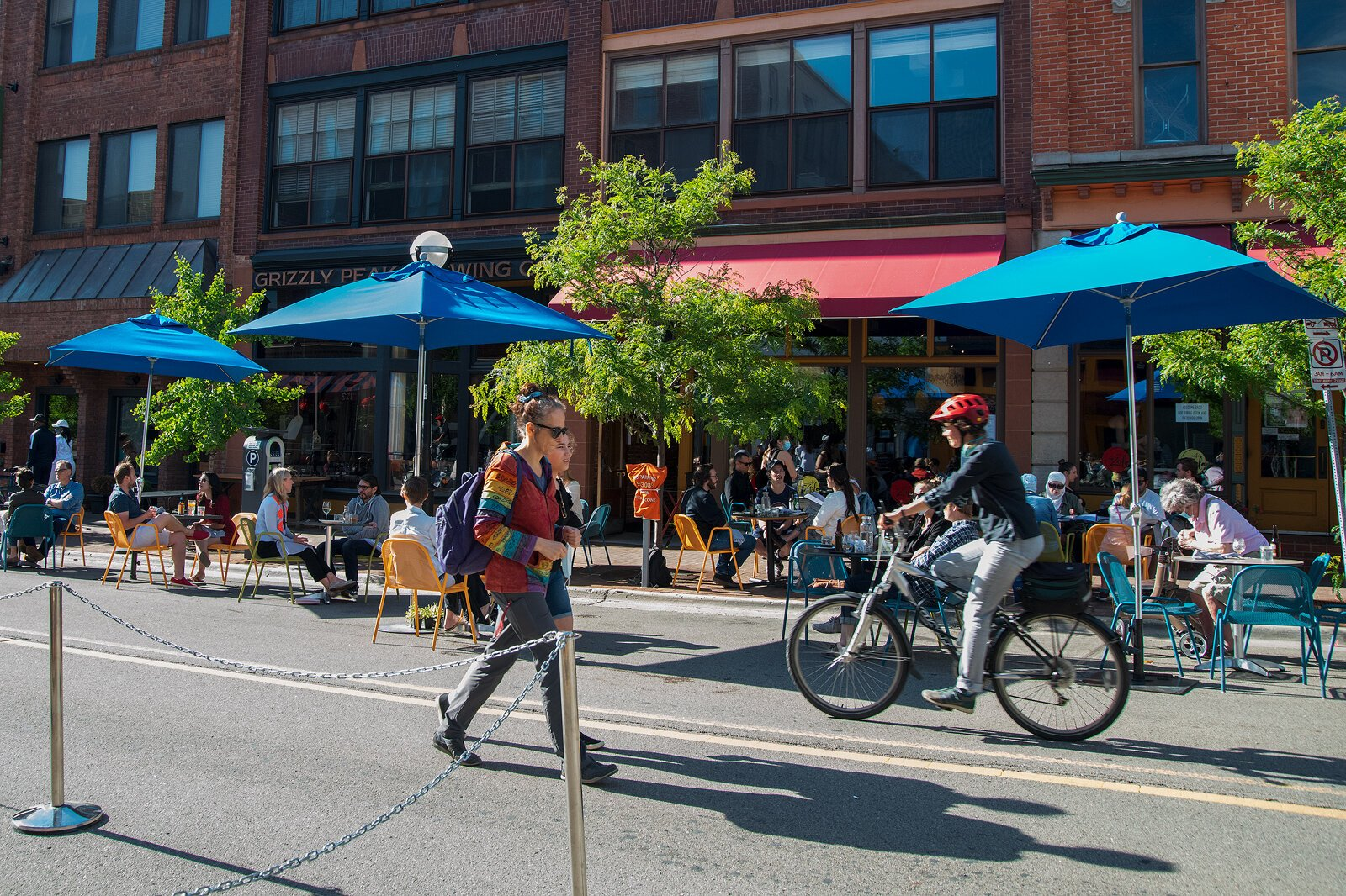 People walk and bike down Washington Street in Ann Arbor.
