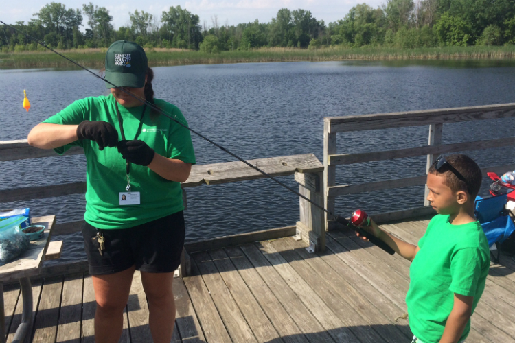 Alison Clemons of Genesee County Parks even helps participants get their hook baited during the Kids Fishing Club events.
