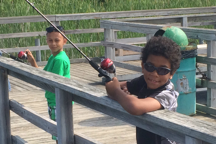 Camron (left) and Javon participated in the first Kids Fishing Club hosted by the Genesee County Parks this summer. Eight others are scheduled in Flint and Clio.
