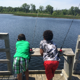 The boys wait, as patiently as possible, for a bite during the Kids Fishing Club event at Buell Lake this month.