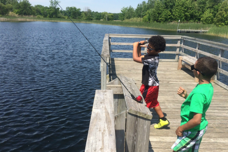 """Oh, wow,"" said Javon (left) after his perfect first cast with his first and never-before-used fishing rod."