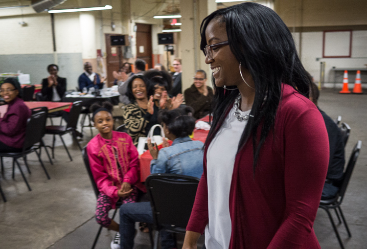 Porcha Clemons walks toward the podium to receive her winning microgrant at the Flint SOUP event in October 2017 at Factory Two in Flint. She won more than $1,300 for her dance studio.