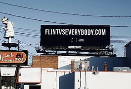 A FLINT VS EVERYBODY billboard on Ballenger Highway.