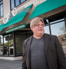 Greg Fiedler, president and CEO of the Greater Flint Arts Council, outside the GFAC gallery and offices on South Saginaw Street in Flint.