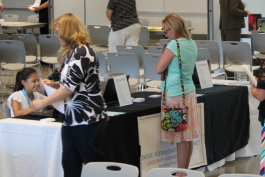 Alexandra Sexton (sitting) volunteers during the 2017 job fair at GISD.