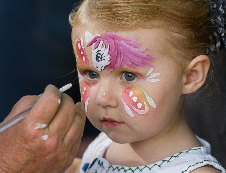 Hadlee Deines, 3, has her face painted at the 8th Annual Miracle Picnic at the Sloan Museum. She was treated for leukemia at Hurley Children's Hospital.
