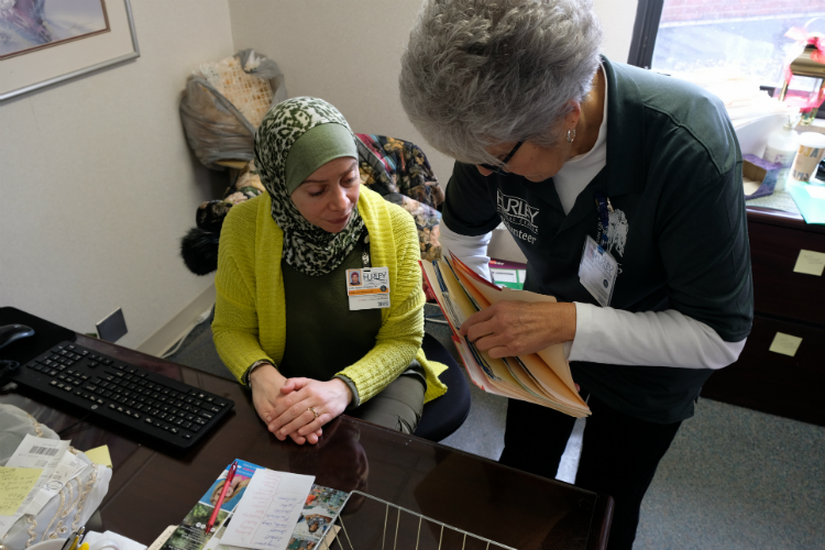 HELP program director Ruba Mahfouz Alkotob and volunteer Millie Hursin discuss patient needs at Hurley Medical Center.