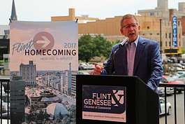 With the under-renovation Capitol Theatre in the background, Phil Hagerman talks about the importance of Flint Homecoming 2017 at a press conference Wednesday, June 28, 2017.