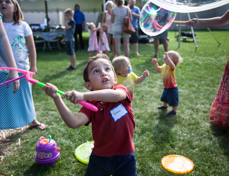 Isaac Sepanak, 3, of Linden swings at a bubble at the 8th Annual Miracle Picnic at the Sloan Museum. He was at the picnic with his mother, who is a nurse at Hurley.