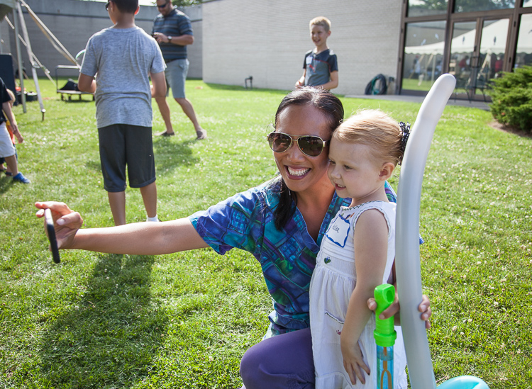 Hadlee Deines, 3, poses for a selfie with a Hurley nurse at the 8th Annual Miracle Picnic at the Sloan Museum on Tuesday.