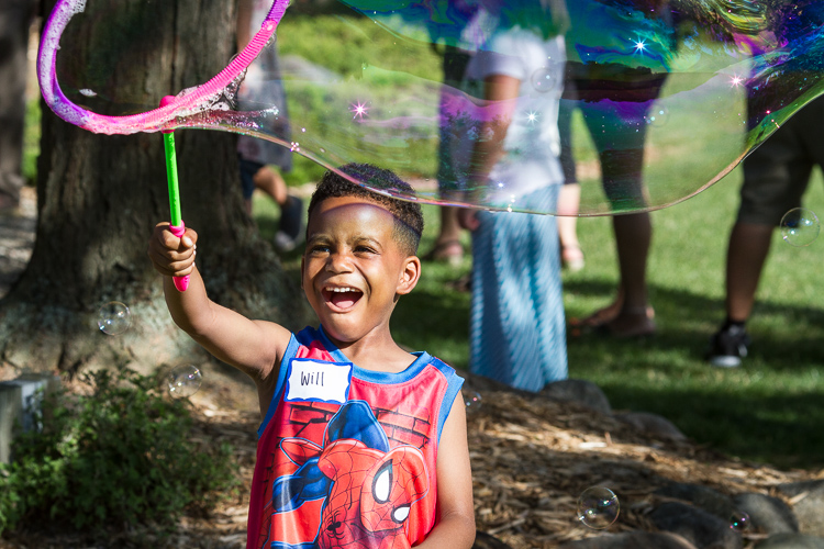 Will Morgan III, 6, of Flint Township creates a bubble at the 8th Annual Miracle Picnic.  Will receives his last treatment for leukemia next month at Hurley Children's Hospital.