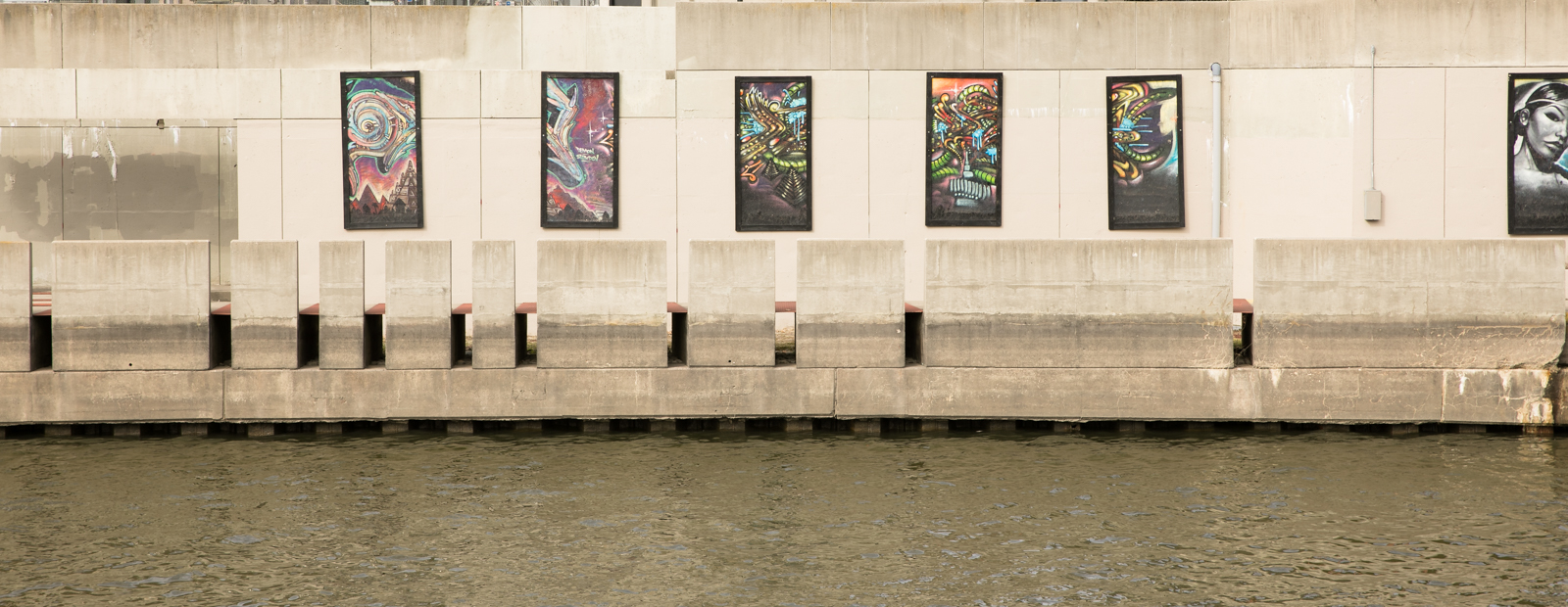 Murals line the Flint River in Riverbank Park