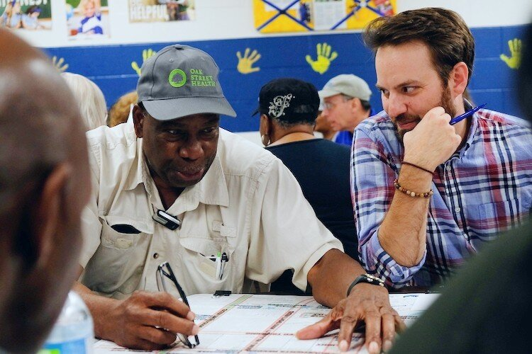 President of Civic Park Neighborhood Association, Joe King (left) explores a talking point with Lead Planner, Adam Moore during a focus group held for September 7 neighborhood planning meeting.