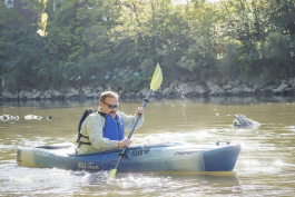 Mike Walsh of Burton begins to paddle down the Flint River at Kayak Flint.