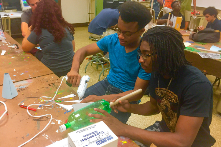 Using bottles, cardboard tubes, glue guns and some know how—high school students build rockets in Kettering's AIM program.